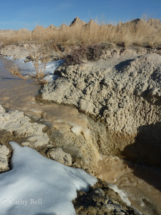 "18"" high waterfall in Badlands National Park, the result of melting snow"