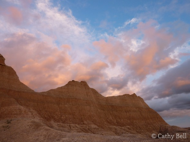 sunset lights up the clouds over the Badlands
