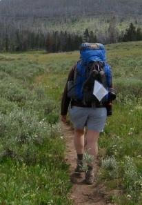 backpacker carrying blue Gregory Deva 60 pack