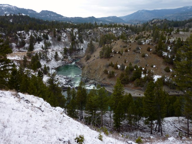 blue-green waters of Yellowstone River in snowy landscape